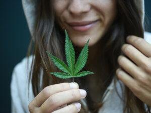 hooded girl with marijuana leaf