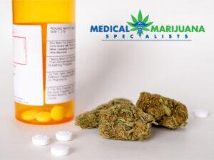 marijuana and bottle of prescription pills
